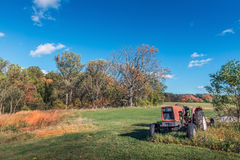 Rustic tractor in a field on a Maryland Farm during Autumn Royalty Free Stock Images