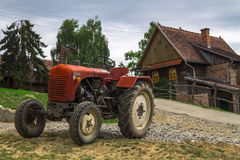 Rustic tractor and house Royalty Free Stock Image