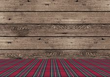Rustic tradional wooden Christmas background with red and green plaid pattern ground. Beautiful rustic tradional wooden Christmas background with red and green Stock Photos
