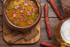 Rustic traditional beer soup with cheese sausage Stock Photos