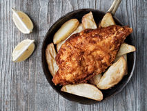 Rustic traditional english fish and chips Royalty Free Stock Photos