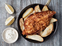 Rustic traditional english fish and chips Stock Photos