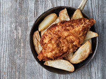 Rustic traditional english fish and chips Stock Image