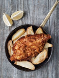 Rustic traditional english fish and chips. Close up of rustic traditional english fish and chips Royalty Free Stock Image