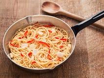 Rustic traditional italian aglio olio spaghetti pasta Royalty Free Stock Images