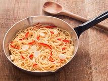 Rustic traditional italian aglio olio spaghetti pasta Royalty Free Stock Photo
