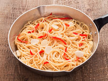 Rustic traditional italian aglio olio spaghetti pasta Stock Images