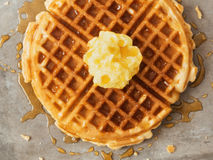 Rustic traditional waffle with butter and maple syrup Stock Images