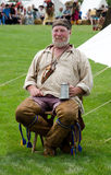 Rustic trapper at a festival Royalty Free Stock Images