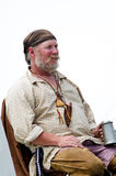Rustic trapper with a mug of ale Royalty Free Stock Photography