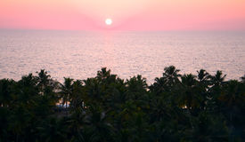 Rustic tropical sunrise on a ocean in Asia. Stretching from glowing lanterns to daylight Stock Images