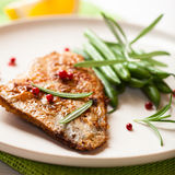Rustic turbot fillet with french beans Royalty Free Stock Images