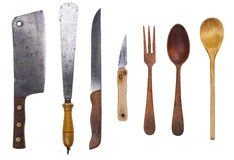 Rustic utensil set. Set of rustic utensil. Cleaver, trowel, knifes, wooden spoons and fork. Isolated with clipping path Stock Images
