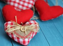 Rustic Valentine. Shabby chic red and white gingham hearts with rustic decorations of buttons, straw and hessian, valentine and Christmas decorations Stock Photography