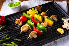 Rustic vegetable shashlik with green asparagus and paprika Stock Photos