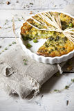 Rustic vegetables french quiche with peas on baking dish on vintage background Royalty Free Stock Image