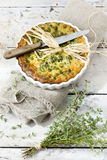 Rustic vegetables french quiche with peas on baking dish on vintage background Royalty Free Stock Images