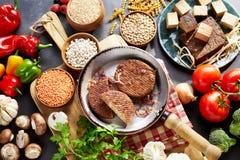 Rustic vegetarian ingredients on timber table Stock Image