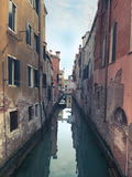 Rustic Venice Canal. View Down Authentic Venetian Residential Canal Stock Photo