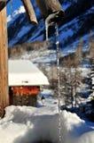 Rustic village fountain in frozen village Stock Photo