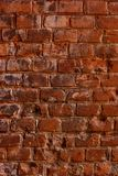 Rustic vintage bakcground of red brick wall. Cladding with cement seams stock image