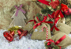 Rustic vintage Christmas decorations. On snow Royalty Free Stock Photo