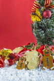 Rustic vintage Christmas decorations. On snow with red background Royalty Free Stock Image