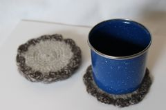 Rustic Vintage Enamelware Blue Cup and Handmade Knit Coaster royalty free stock photography