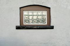 Block Glass Window in Stucco Wall Stock Images
