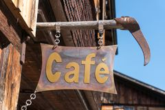 Rustic vintage metal sign for a coffee shop up close. Horizontal view of a rustic vintage metal sign for a coffee shop up close royalty free stock photo