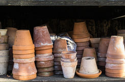 Rustic vintage stacks of terracotta flower pots. Old rustic vintage stacks of terracotta flower pots Royalty Free Stock Photography