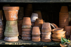 Rustic vintage stacks of terracotta flower pots. Old rustic vintage stacks of terracotta flower pots Royalty Free Stock Photos
