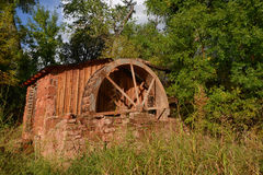 Rustic and vintage water mill Stock Photos