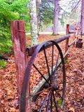 Rustic wagon wheel on a fence Royalty Free Stock Image