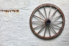 Rustic wagon wheel hanging on Stock Images