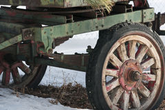 Rustic Wagon Wheels. The wheels on an antique hay wagon sitting in the snow Royalty Free Stock Photos