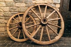 Rustic wagon wheels in front of the wall in old city Baku Azerbaijan Stock Photo
