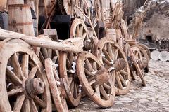 Rustic wagon wheels in front of the wall Royalty Free Stock Image