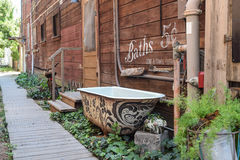 Rustic Walkway, with Painted Claw-Foot Tub Royalty Free Stock Images
