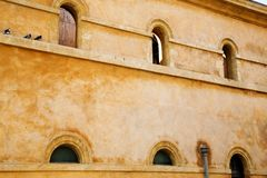 Rustic wall with arched windows Stock Images