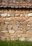 Rustic wall with layers of different comstruction materials Stock Photos