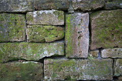 Rustic wall of natural stones as a background Stock Images