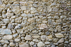 Wall Pebbles. Rustic wall in a old construction Stock Images