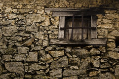 Rustic wall and window. Detail of a rustic rural wall and an old window royalty free stock images