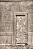 Rustic walled-up door Stock Photography