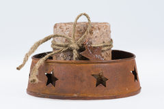 Rustic wax candle in barn star holder Royalty Free Stock Image