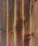 Rustic weathered barn wood background with knots and nail holes. Stock Images