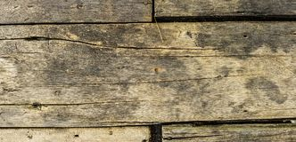 Rustic weathered barn wood background with knots and nail holes Stock Photography