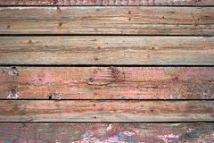 Rustic weathered barn wood background painted in red color Royalty Free Stock Photos