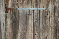 Rustic weathered barn wood with a piece of metal and nails Royalty Free Stock Photography